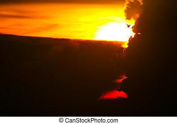 sunrise on silhouette cloud and ray sky fishing boat on sea island
