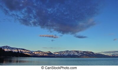 Sunrise on Tahoe lake - Panoramic time-lapse of sunrise on...