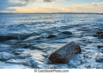 Sunrise on the Baltic Sea with rocks and rocky coastlines