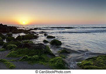 Sunrise on the beach in Pomorie resort in Bulgaria