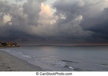 sunrise on the beach next storm