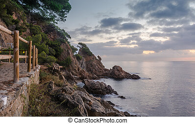 Sunrise on the beach of Blanes in the heart of Costa Brava in Spain.