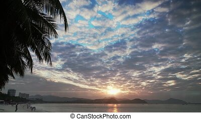 sunrise on the beach of island Hainan