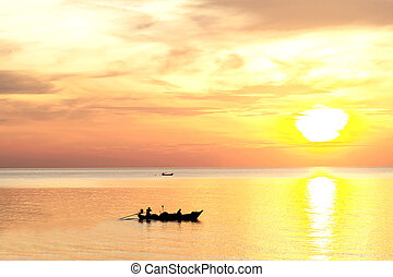 Sunrise on the beach with fishing boat in the morning