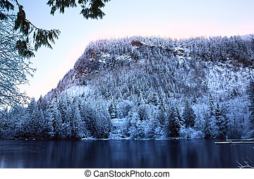 Sunrise on the High Mountain Lake, Lake Walker with Mount Enumclaw towering above it, Cascade Mountain Range, just north of Mount Rainier, Washington, USA.