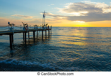 Sunrise on the sea with a pier in Kemer