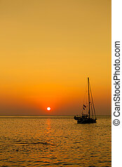 Sunrise on the sea with boat