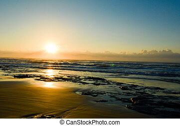 Sunrise on Torres beach, Brazil.