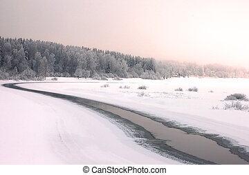 Sunrise over a misty river in winter