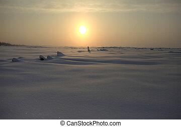 Sunrise over a misty sea shore in winter