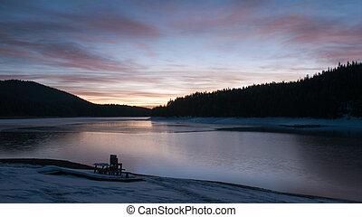 Sunrise over a mountain lake