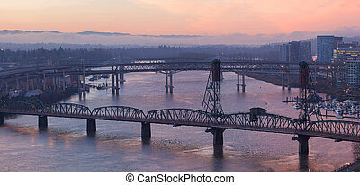 Sunrise Over Bridges of Portland Oregon downtown cityscape along Willamette River Aerial View Panorama
