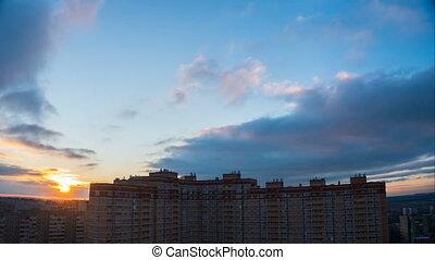 Sunrise over city skyline
