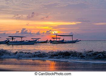 sunrise over fishing boats on Bali