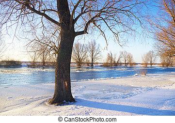 Sunrise over frozen river