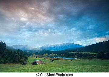 sunrise over Geroldsee lake and alpine meadows