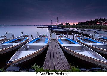 sunrise over lake harbor