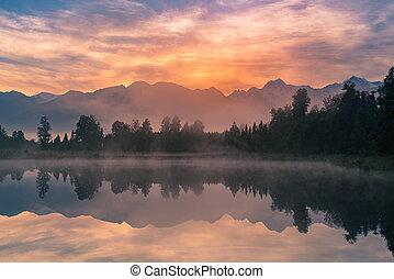 Sunrise over Matheson lake with Fox mountain