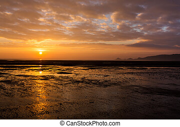 Sunrise over Mumbles mudflats