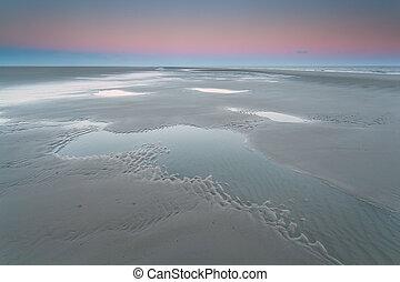 sunrise over North sea coast at low tide