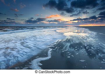 sunrise over North sea coast during low tide