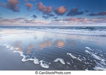 sunrise over North sea waves, Schiermonnikoog, Netherlands