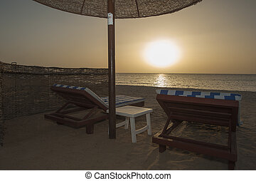 Sunrise over ocean on tropical resort beach