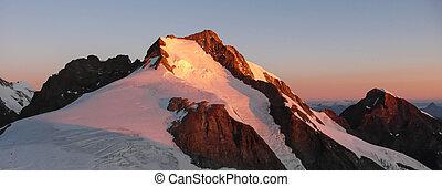 sunrise over Piz Bernina in the Swiss Alps
