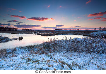 sunrise over river in winter, Onlanden, Drenthe, Netherlands