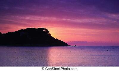 Sunrise over sea fast motion.