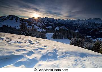 sunrise over snowy mountains