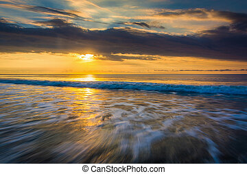 Sunrise over the Atlantic Ocean in Folly Beach, South Carolina.