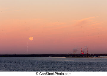 sunrise over the bay with the moon