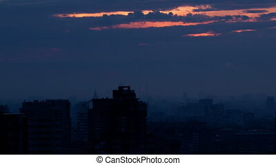 Sunrise over the city. Time lapse with panning.