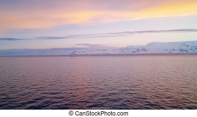 Sunrise Over The Coastline Of Antarctica