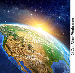 Very high definition picture of planet earth in outer space with the rising sun. Elements of this image furnished by NASA