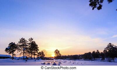Sunrise over the farmhouses. Winter. Time Lapse. 4K