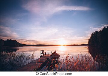 Sunrise over the fishing pier at the lake in Finland