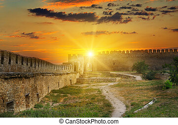 Sunrise over the fortress wall of a medieval fortress. Akkerman Ukraine