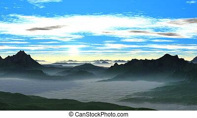 Sunrise over the misty hills