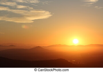Sunrise over the Mountains - Daybreak over the foothills of...