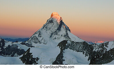 sunrise over the north face of the Matterhorn