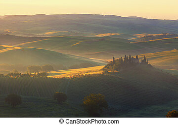 Sunrise over the rural house with vineyards in San Quirico d'Orcia, Tuscany, Italy
