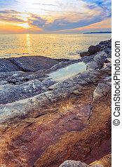 Sunrise over the sea near Rt Kamenjak - Beautiful rocks and...