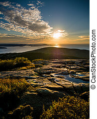 Sunrise over the sea on top of Cadillac Mountain in Acadia...