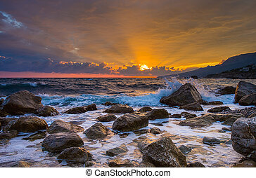 sunrise over the sea - Waves break about stones at sunrise...