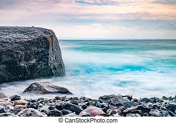 Sunrise over the sea. Stone on the foreground. Colorful ...
