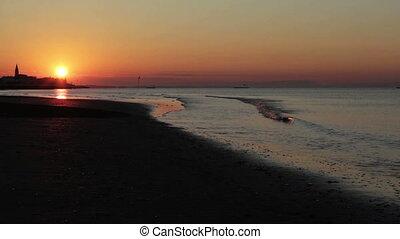 sunrise over the sea with church si