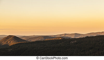 sunrise over the trees and mountains of Lassen volcanic national park
