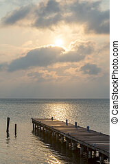 Sunrise Over Wooden Jetty